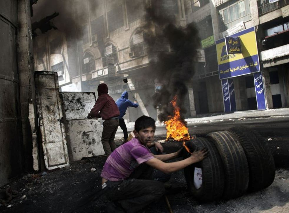 A Palestinian demonstrator looks on during clashes with the Israeli army in Hebron