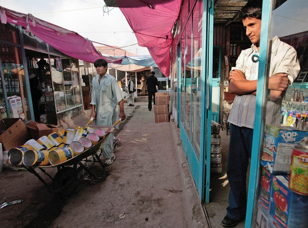 A merchant waits for business at the Bush Bazaar in Kabul, Afghanistan