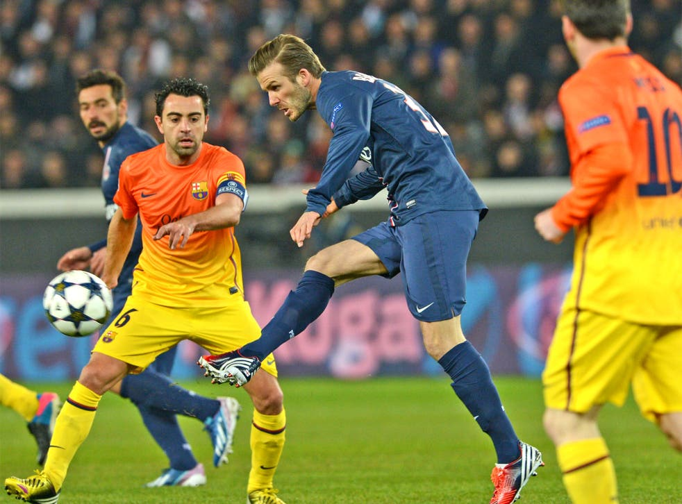 David Beckham goes past Xavi and Lionel Messi in Paris