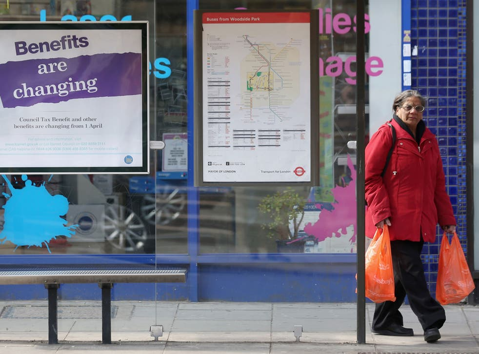 Hitting home: A bus-shelter poster warns of changes to the benefits system