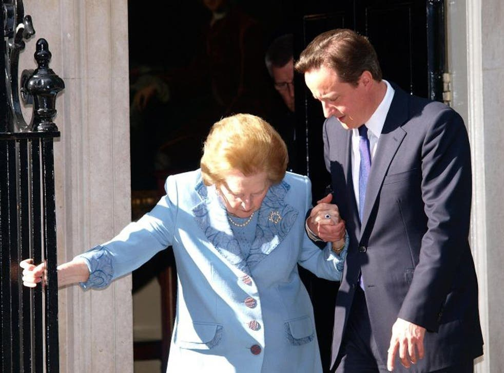 Prime Minister David Cameron helping Baroness Thatcher outside Downing Street