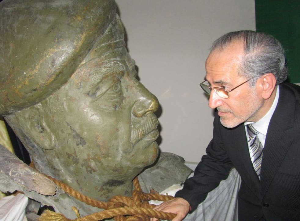 Dr Mowaffak al-Rubaie with a bust of the deposed dictator from one of his palaces and the ropeused to hang him