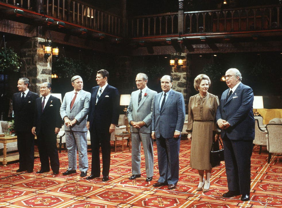 U.S. President Ronald Reagan (c) surrounded by (l-r) President of the European Union commission Gaston Thorn, Japanese Premier Zenko Suzuki, German Chancellor Helmut Schmidt, Canadian Prime Minister Pierre Elliott Trudeau, French President Frantois Mitterrand, British Premier Margareth Thatcher and Italian Prime Minister Giovanni Spadolini during the Summit of the leading industrial countries, in Ottawa, 18 July 1981.