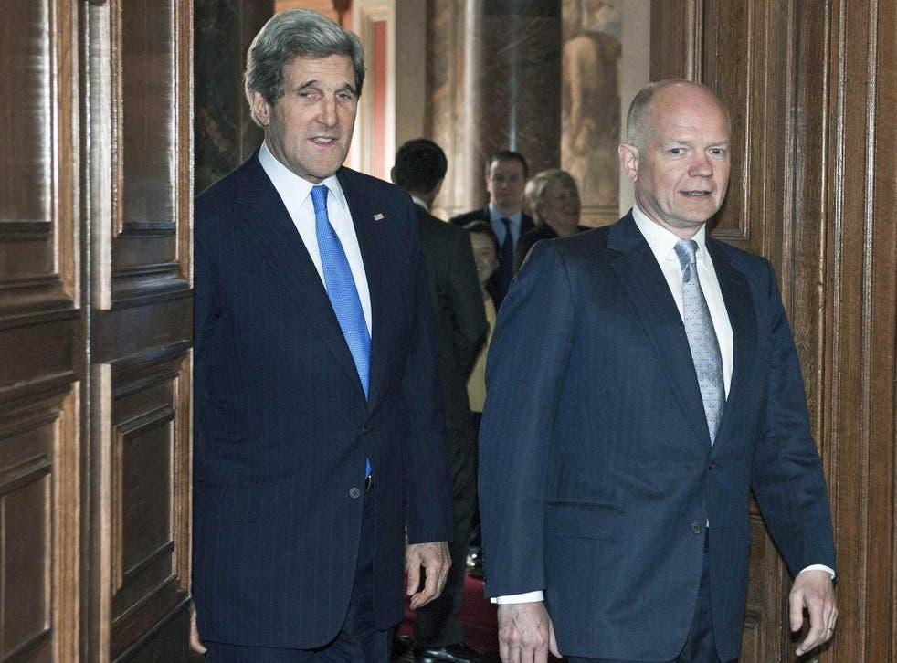 Foreign Secretary William Hague walks with US Secretary of State John Kerry