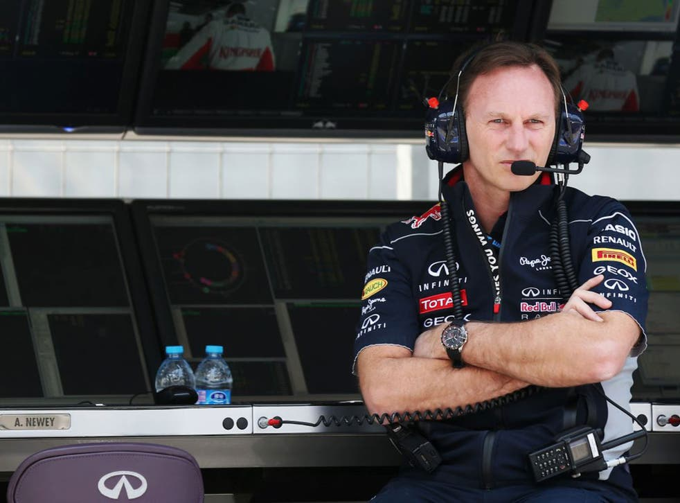 Christian Horner, the Red Bull team principal, watches his German driver Sebastian Vettel on track in practice yesterday