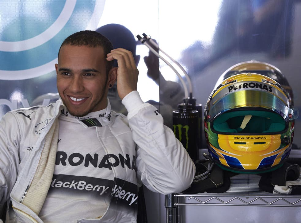 Smiles ahead: Lewis Hamilton is delighted after taking pole for Mercedes