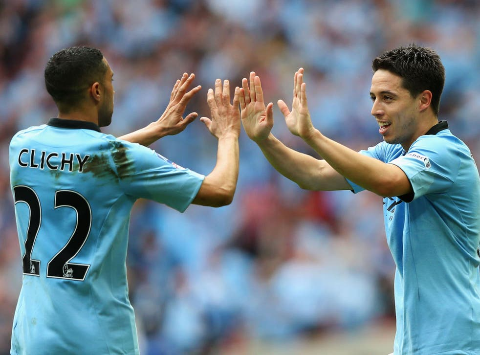 Samir Nasri of Manchester City celebrates with Gael Clichy