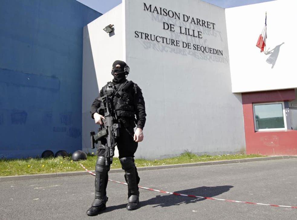 Europe-wide alert issued after 'celebrity' robber and murder suspect takes prison guards hostage after firing a gun and using plastic explosives hidden in a hankerchief to break out