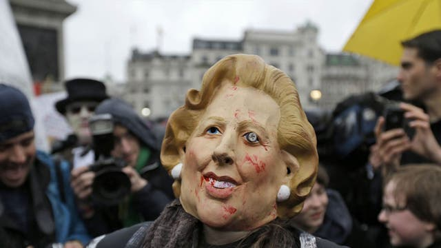 A protester during a party in Trafalgar Square at the weekend celebrating Lady Thatcher's death. A full military rehearsal for the funeral took place in the early hours of this morning in preparation for Wednesday