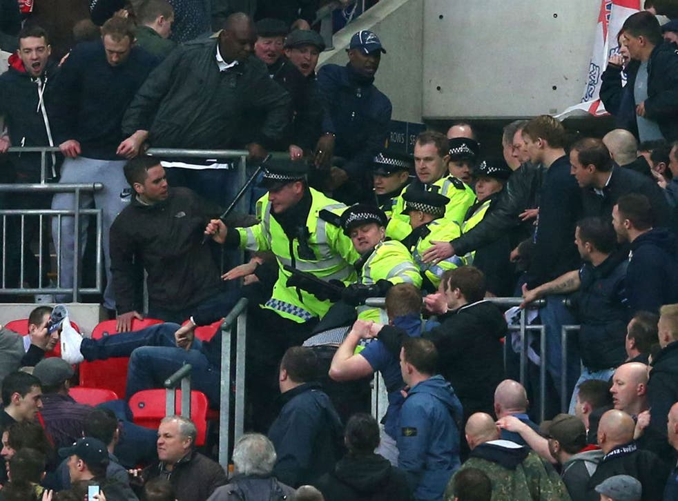 Millwall supporters clash with police at Wembley on Saturday