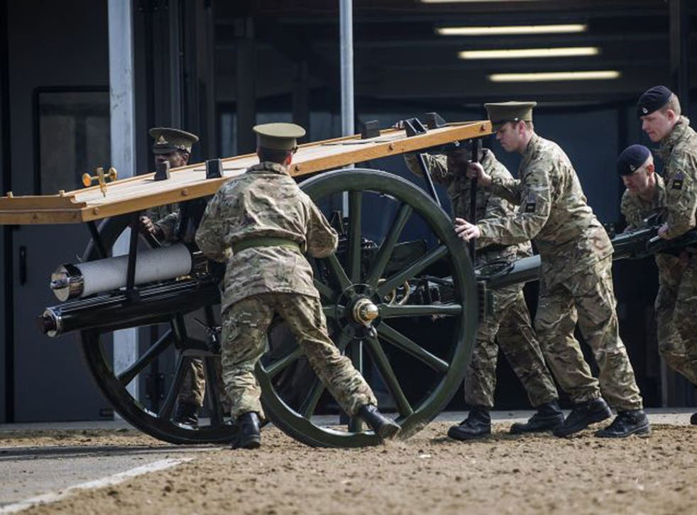 Soldiers prepare the ceremonial cannons before Margaret Thatcher's funeral