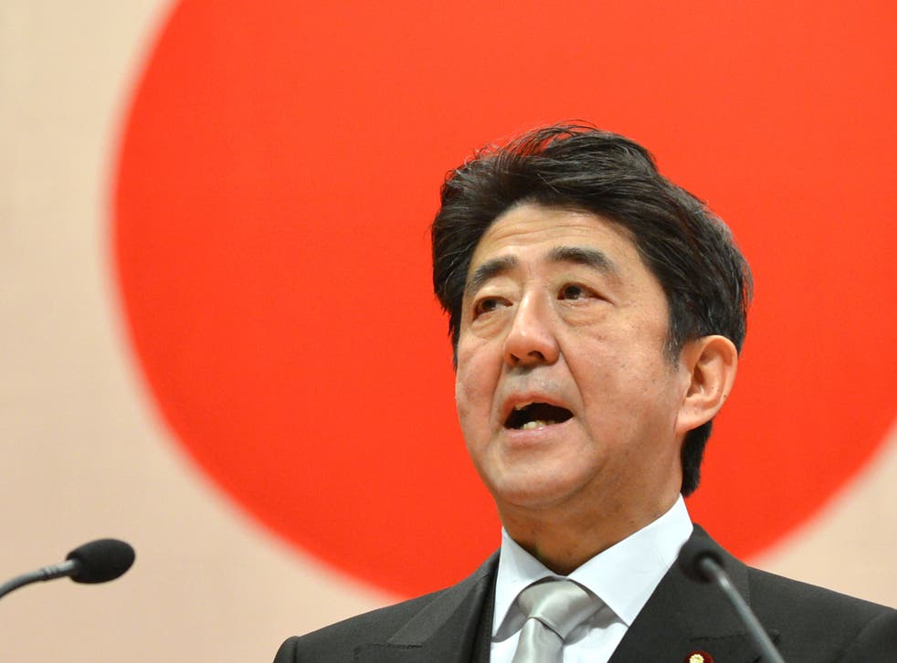 Japanese Prime Minister Shinzo Abe delivers a speech during a graduation ceremony at the National Defense Academy in Yokosuka, Kanagawa Prefecture on March 17, 2013.