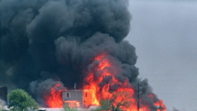 The Branch Davidian compound in flames in 1993 after a shootout following a 51-day siege: 76 sect members died inside