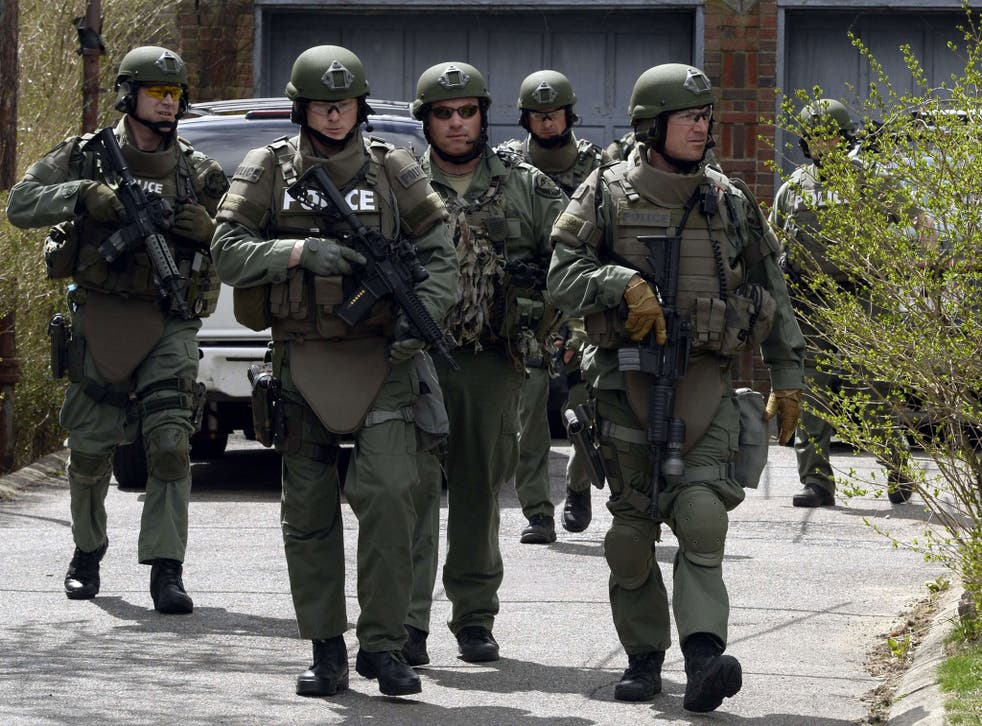 Home watch: A police Swat team searching Watertown, Boston, on Friday