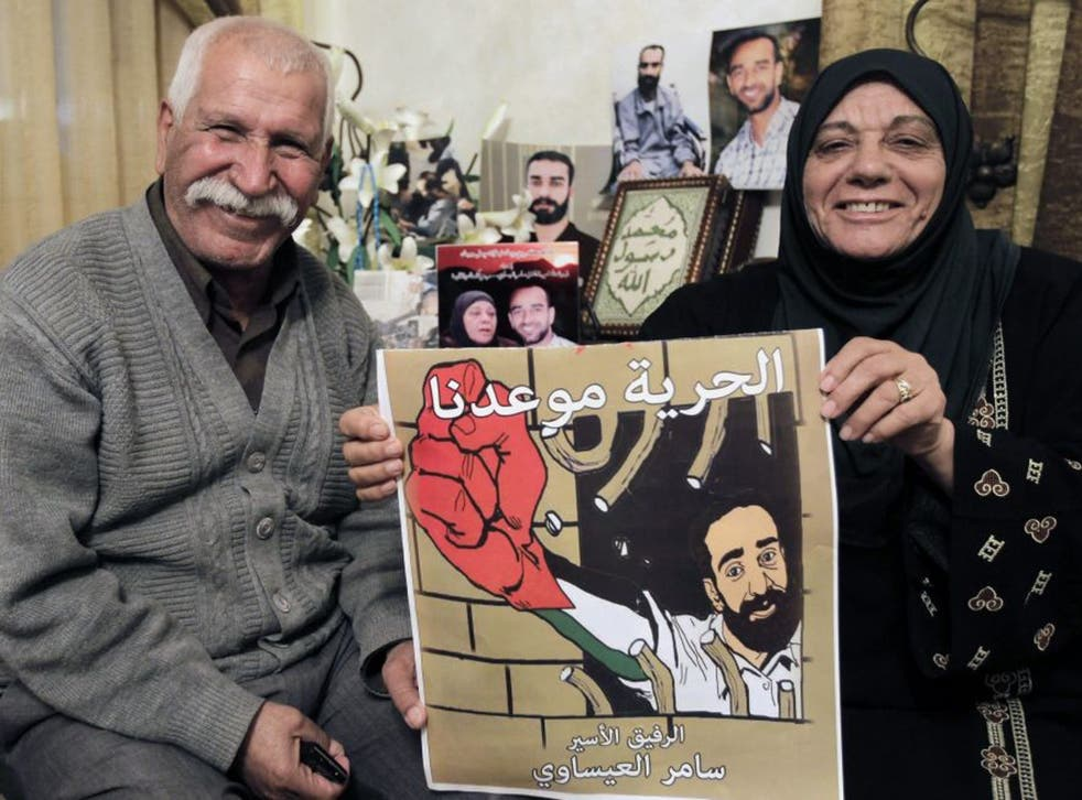 The parents of Palestinian hunger-striking prisoner Samer Issawi at their home in the Issawiya neighborhood in Arab East Jerusalem as they rejoice that their son has decided to end his hunger strike