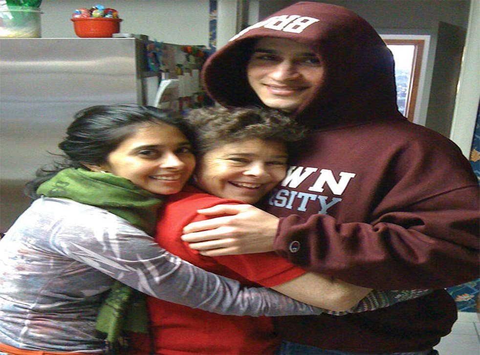Sunil Tripathi in happier times pictured at home with his mother and sister