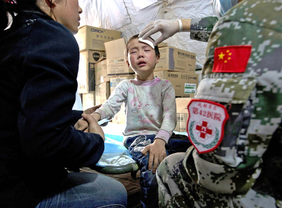 A child gets treatment in a military field hospital in Lushan, Sichuan