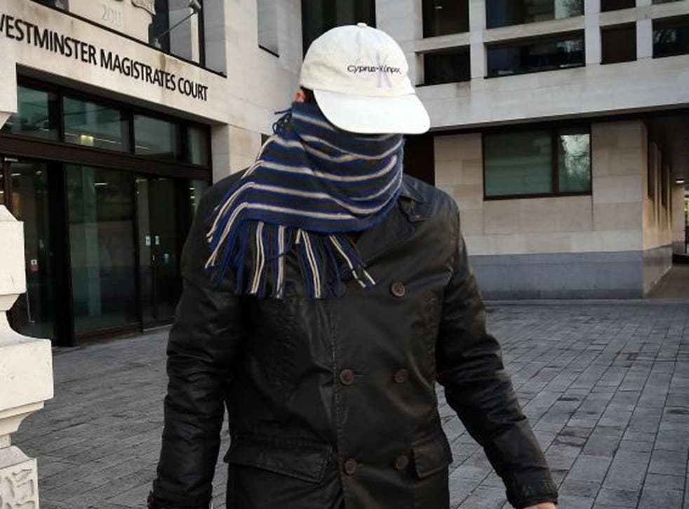 Mark Lancaster left the court with his face swathed in a scarf and wearing a baseball cap