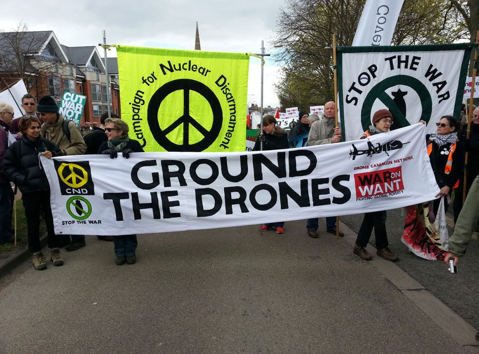 Remote-control warfare: Demonstrators on their way to RAF Waddington yesterday