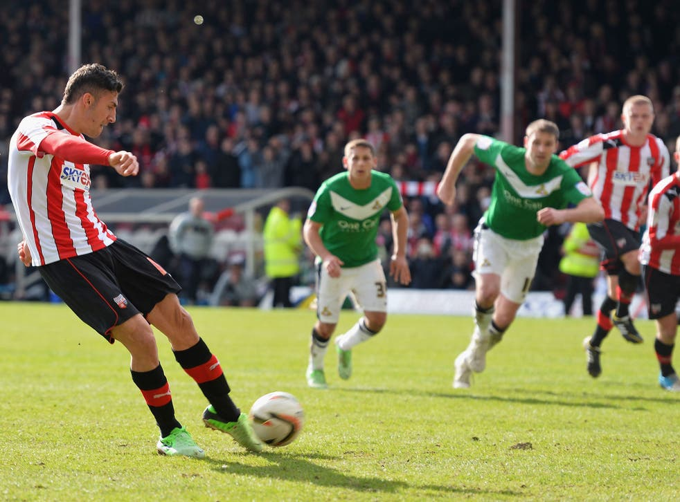 Spot of bother: Brentford substitute Marcello Trotta about to hit his late penalty against the bar