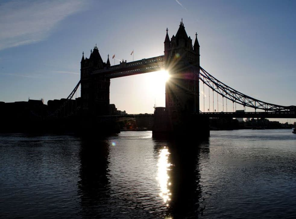 4 May 2013: The sun rises over Tower Bridge in London