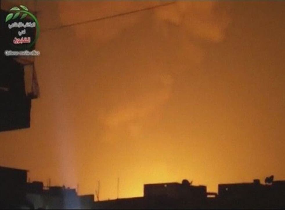 A still from an unverified video which claims to show sky lit up by an attack on a military research centre in Damascus
