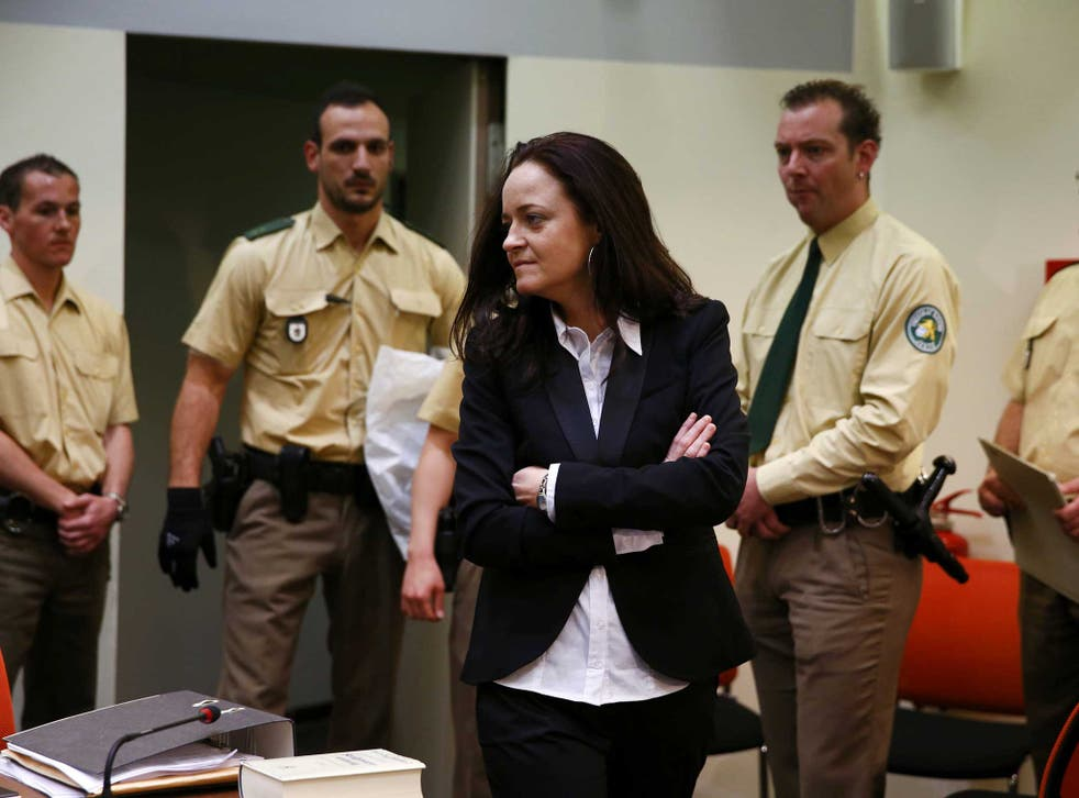 Beate Zschaepe, a member of the neo-Nazi group National Socialist Underground (NSU) stands in the court before the start of her trial