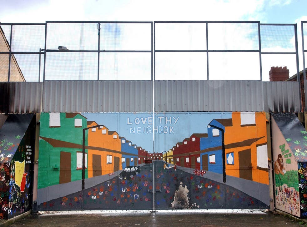 A brightly coloured security gate on the peace line in the nationalist Short Strand area of Belfast