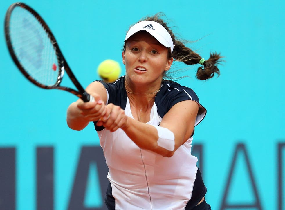 Laura Robson of Great Britain plays a backhand in her match against Magdalena Rybarikova of Slovakia during the Mutua Madrid Open tennis tournament at the Caja Magica