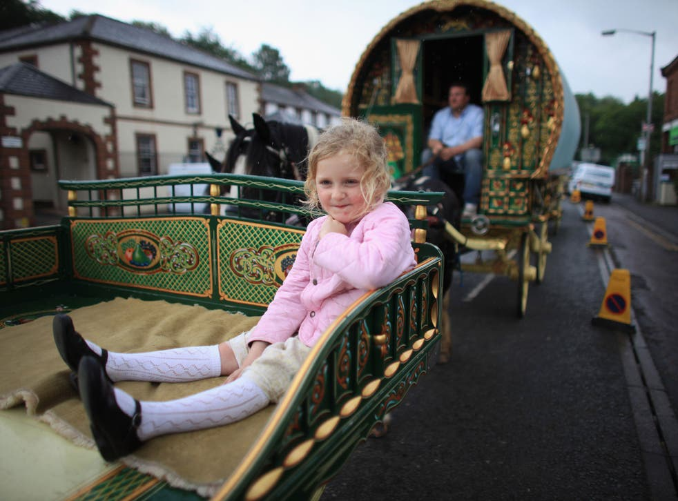 Traveller girl Mary Nicholson, aged six, arrives on her family's Romany Caravan at the Appleby Horse Fair on June 7, 2012 in Appleby, England. Appleby Horse Fair has existed under the protection of a charter granted by James II since 1685. It is one of th