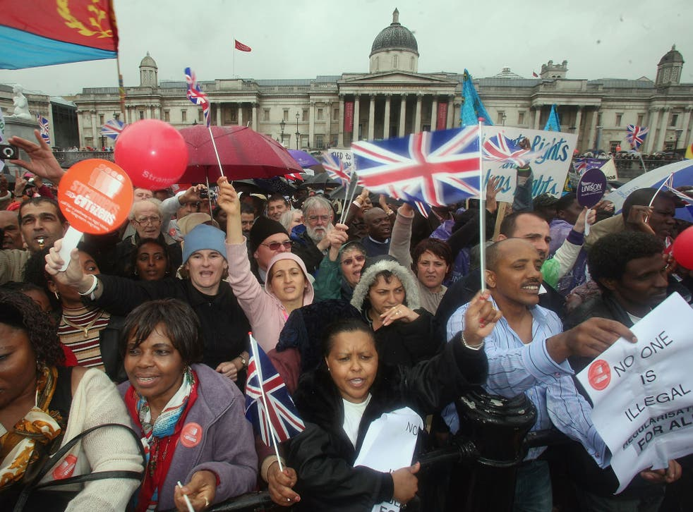 Protestors cheer, wave flags and banners during a march hoping to draw attention to claims of exploitation and discrimination of migrant workers, in Trafalgar Square on May 7, 2007 in London.