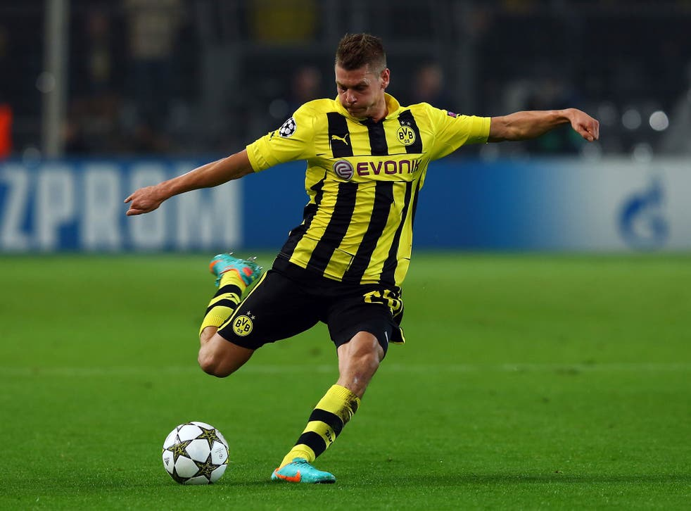 Lukasz Piszczek of Dortmund runs with the ball during the UEFA Champions League group D match between Borussia Dortmund and Real Madrid