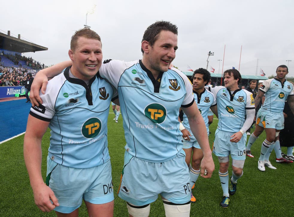 Northampton Saints captain Dylan Hartley celebrates with teammate Phil Dowson after their semi-final success