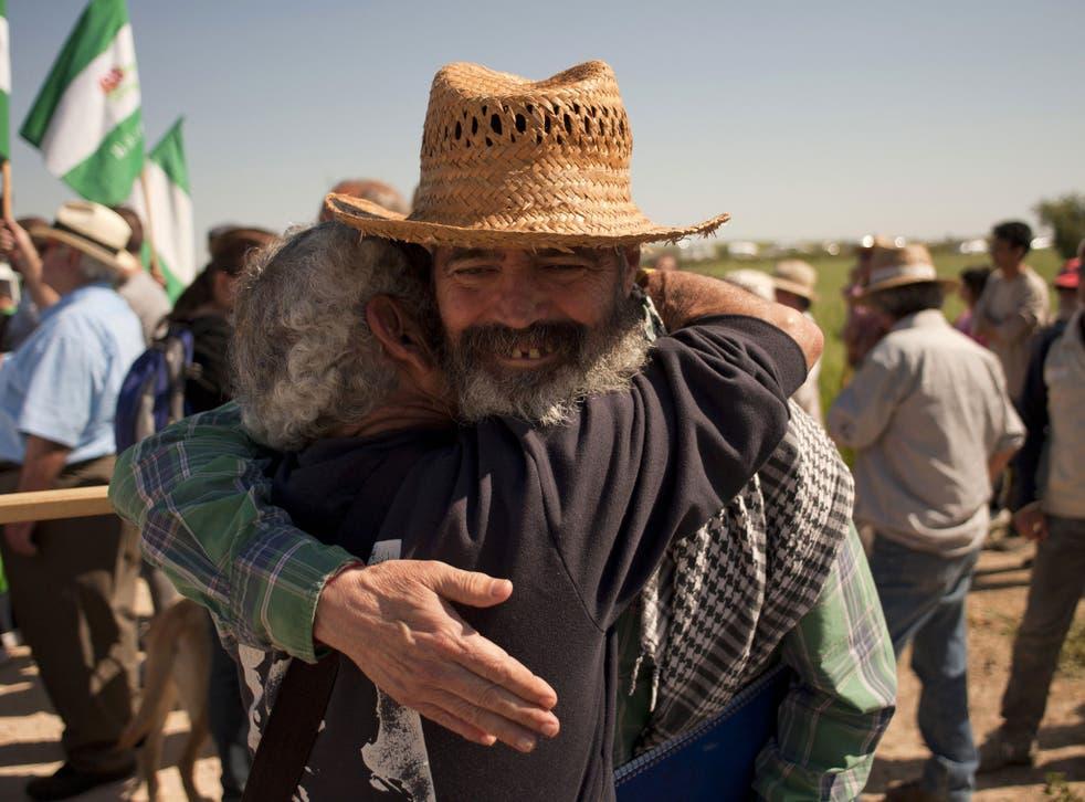 Juan Manuel Sánchez Gordillo embraces an activist during a land occupation this month