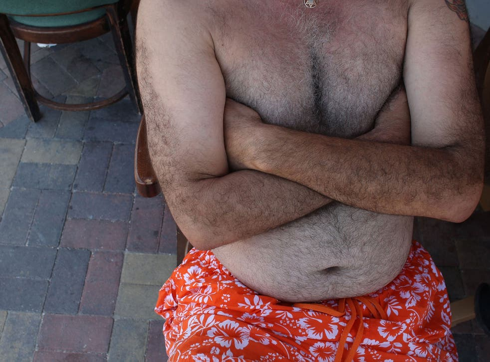 A shirtless man sits outside August 31, 2007 in Hollywood, Florida.