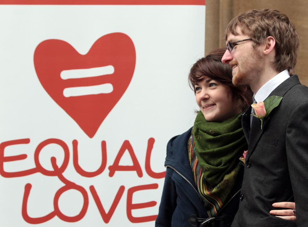 Heterosexual couple, Ian Goggin and Kristin Skarsholt pose for a photograph after being refused a civil partnership outside Bristol Register Office on November 23, 2010 in Bristol, England.