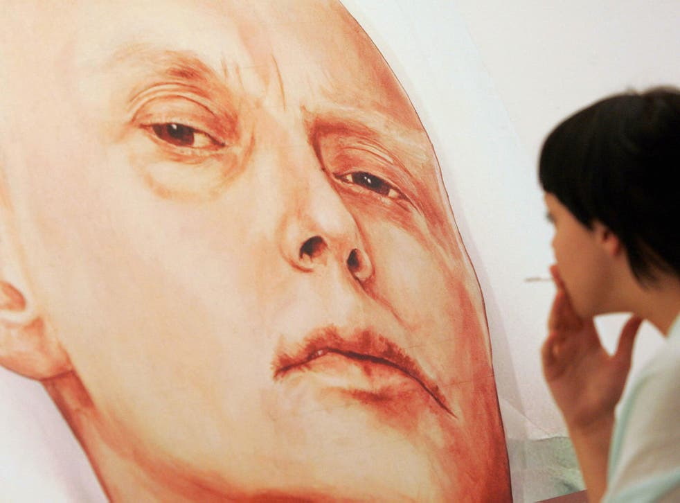 A visitor looks at a painting showing former Russian spy Alexander Litvinenko, by Dmitry Vrubel and Viktoria Timofeyeva painters in the Marat Guelman gallery in Moscow, 23 May 2007.