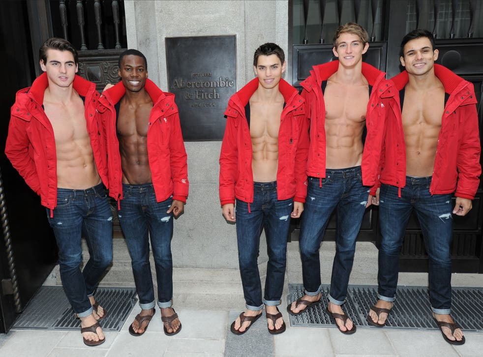 Male models pose outside the Abercrombie & Fitch flagship clothing store
