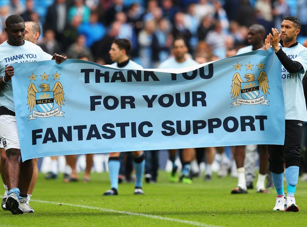 Micah Richards, left, Gael Clichy, right, and the rest of the Manchester City players thank their fans for their support