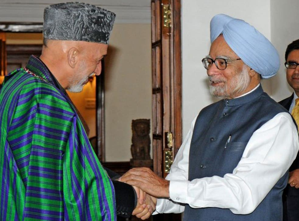 Hamid Karzai, left, is on a two-day visit to India during which he has sought to build on an agreement signed in 2011. Pictured right is Indian prime minister Manmohan Singh