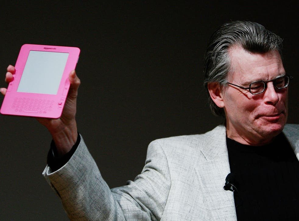 Author Stephen King holds a special pink Kindle given to him by Amazon.com founder and CEO Jeffrey P. Bezos at an unveiling event for the Amazon Kindle 2 at the Morgan Library & Museum February 9, 2009 in New York City.