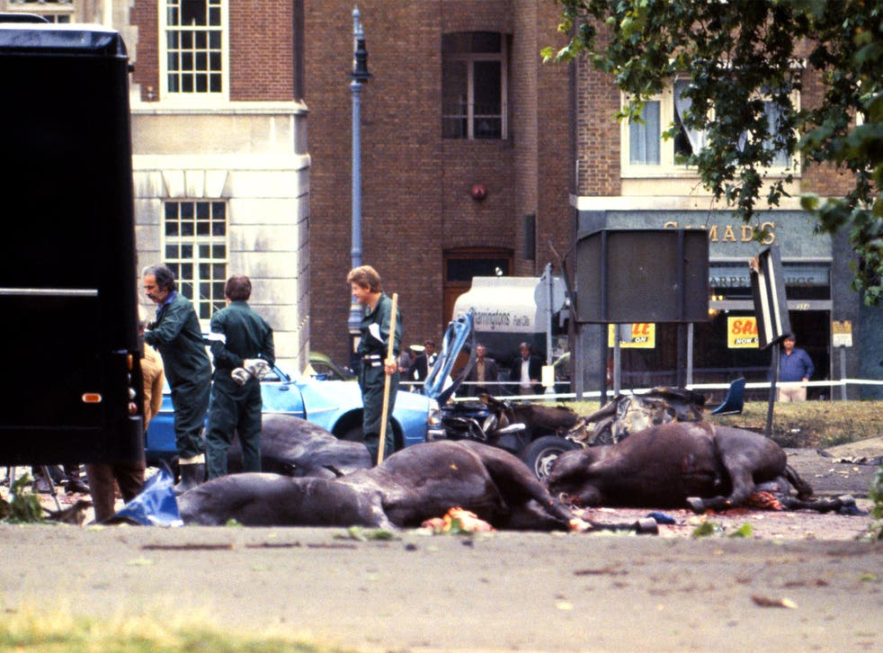 Carcasses of horses of the Household Cavalry lie in the road following the Hyde Park bomb attack