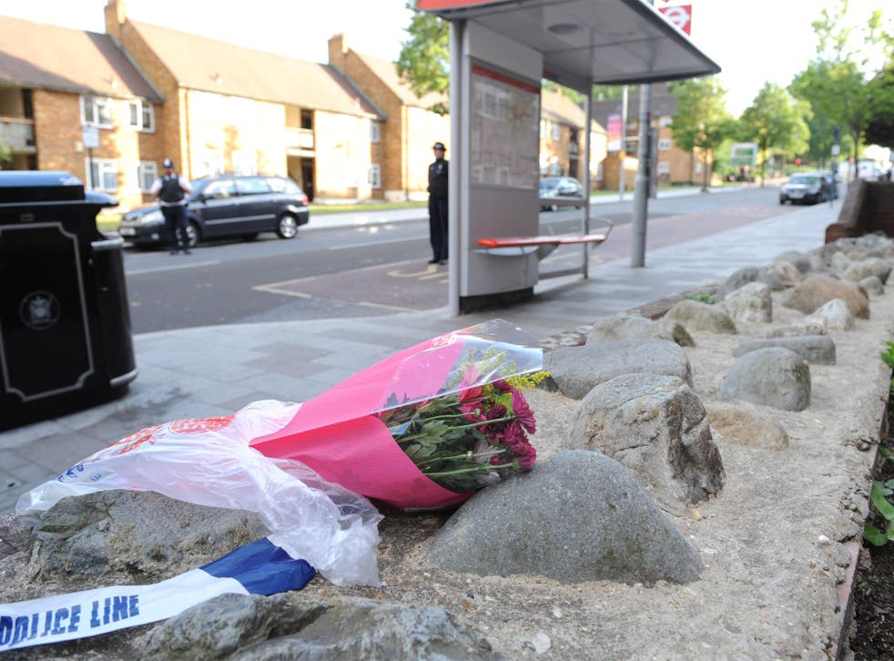 A floral tribute close to the scene where a man was murdered in John Wilson Street, Woolwich
