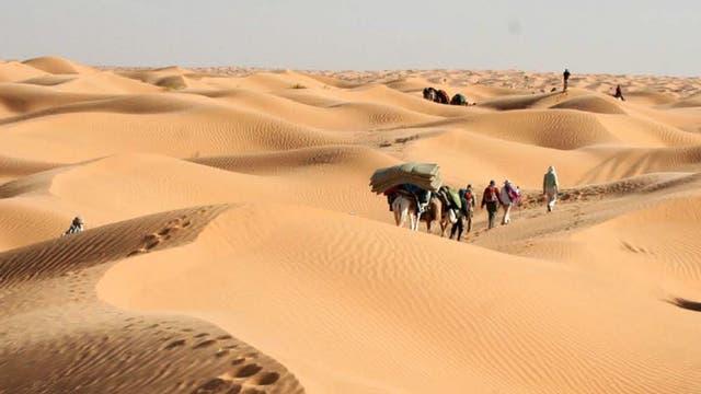 Dune roaming: the group treks across the sands