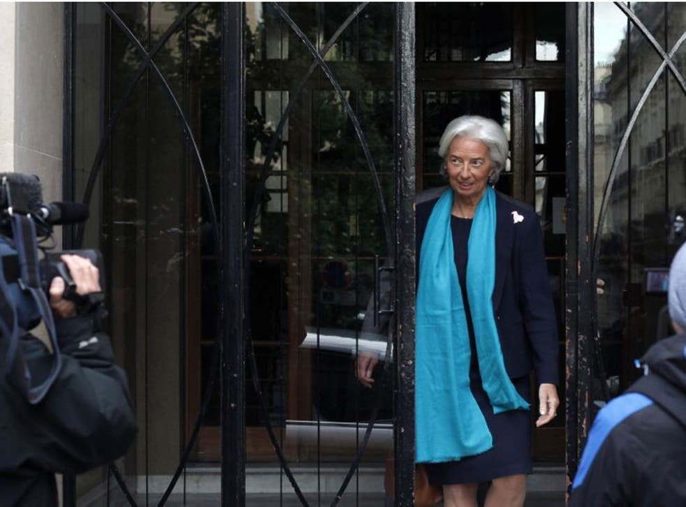 IMF Managing Director Christine Lagarde leaves her apartment building before appearing in a Paris court
