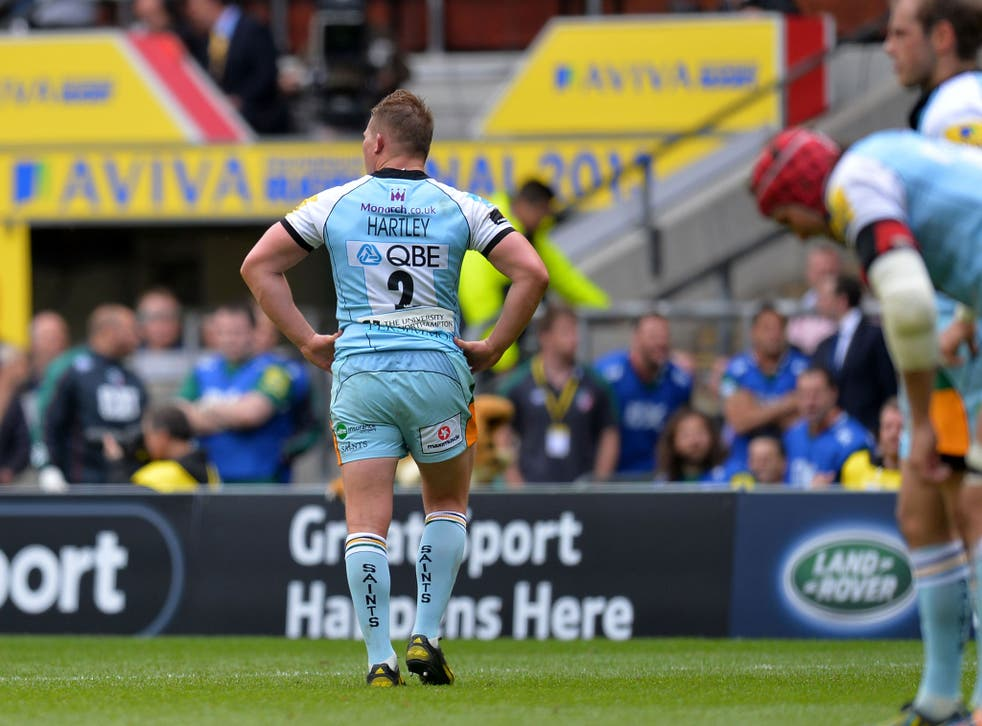 A dejected Hartley leaves the pitch
