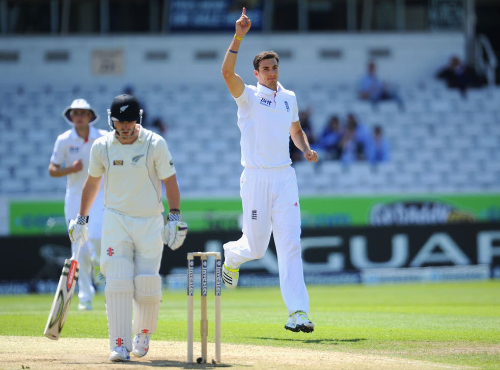 England bowler Steven Finn celebrates after taking the wicket of Hamish Rutherford