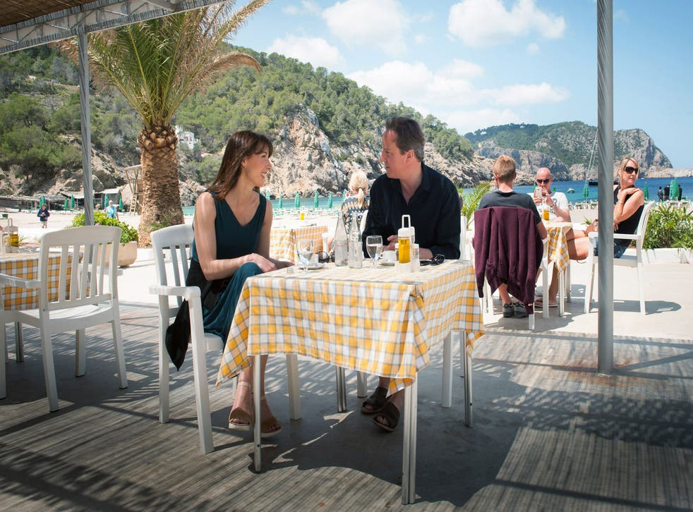 David Cameron with his wife Samantha by the beach. The couple left for Ibiza with their children yesterday