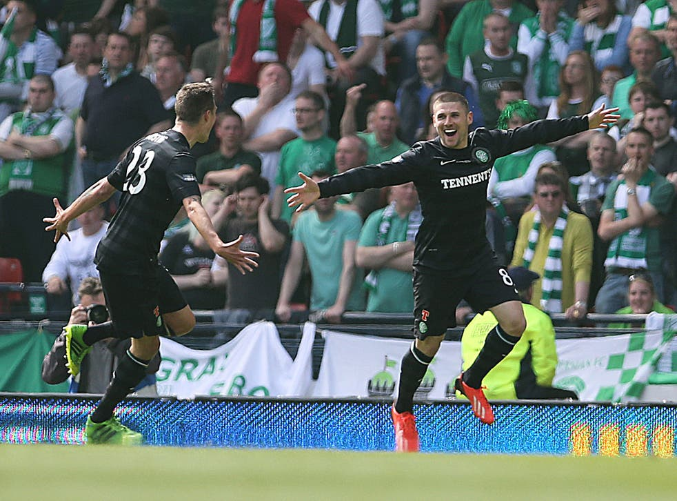 Gary Hooper (R) of Celtic celebrates after scoring the opening goal of the William Hill Scottish Cup Final