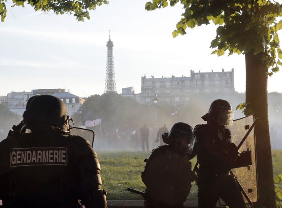 Riot police officers take position (Laurent Cipriani/AP)
